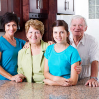 Elder couple and two caregiver