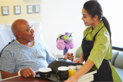 caregiver and male elder talking