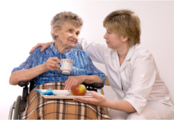 Caregiver talking to female elder